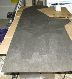 Applying contact cement to back of Formica